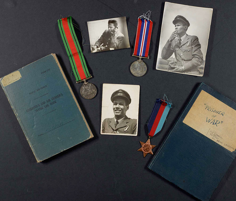 ww2 items relating to Cy Grant's wartime career including log book and medals